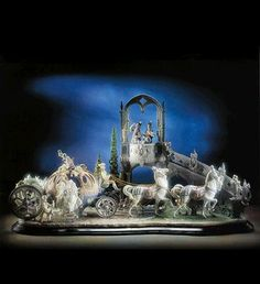 This Lladró I have had the privelege to see in person. If you're a fan...go to the page where you can zoom in. Can't see it on the page, but even the floor of the carriage has a pattern in it. Breathtaking!  http://www.lladro.com/figurines/01001785-CINDERELLA%27S_ARRIVAL/