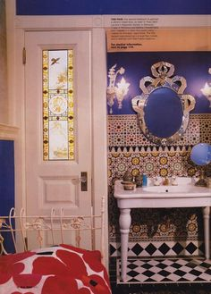 Bathroom dream.colbalt blue paint,  stained glass window, pedestal sink, beautiful Moroccan tiles