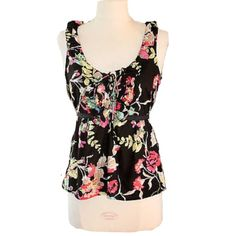 Edme & Esyllte Anthro Sz 10 Floral Ruffle Tie Top Edme & Esyllte Anthro Sz 10 Floral Ruffle Tie Top.   Size: 10 Bust 34-36 (runs a little small) Condition: New without tags ruffle neckline with lace up ties at the bust side zip unlined  Fabric: 100% cotton. Machine wash. Anthropologie Tops