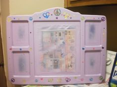 This was a clock ,picture frame that was flat black...a little spray paint, cool stickers & some spray acrylic & it is now a cute memory frame for my granddaughter.
