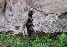 Secret Door Found At Machu Picchu, May Lead To A Fortune In Inca Gold And Silver    Thierry Jamin in front of the main wall of the petroglyphs of Pusharo.