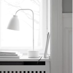 This is the new LIGHTYEARS CARAVAGGIO READ TABLE LAMP- perfect for lighting up a dark workspace !