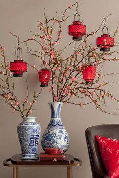 Cherry blossom branches with lanterns