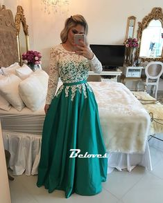 Be the party queen in this amazing green prom gown . It was inspired by the long sleeve with lace top . Would perfect for senior prom or homecoming .  Fabric: Satin Color: Ivory/ Green Skirt: A Line  Neckline: Bateau Sleeve: Long Sleeve Back Detail: Covered Button Back Length: Floor Length Em