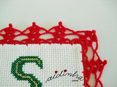 Foto do canto do picô de crochet do individual de Natal