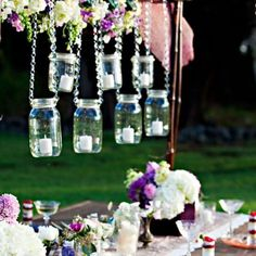 DIY Home Decor: Hanging mason jars with candles inside them can turn ordinary evening meals into romantic ones.