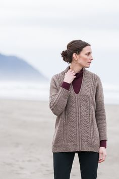Cuddle down in a roomy Shelter tunic with an unusual neckline. The front and back, which are knit flat, feature a central panel of chevrons formed with simple left and right twists and a touch of garter stitch. The patterned sections form a self-finished neck edge and extend from the front to form the collar. …
