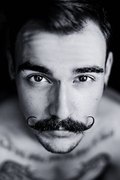 I would very much like to find a guy who can pull off this moustache. :D