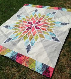Lone Star Bed Quilt - Diamond shapes with 1in white in between. Lovely. E-triangle border