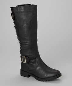 Designed with sleek lines, low heels and crisscrossing embellishments at the ankles, these riding boot-style shoes are posh and practical additions to any outfit.
