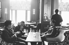 Groom and groomsmen hang out in the lounge of the Ritz Carlton in San Francisco, CA. Captured by NYC wedding photographer Ben Lau.
