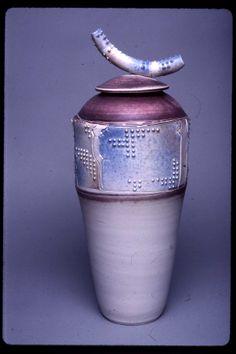 Christy Johnson - Thrown and altered lidded jar; slip dots; egg-shell matt glaze over porcelain; airbrushed oxides; reduction fired.