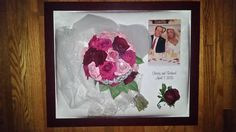 Preserved bridal bouquet and boutonniere with picture, veil, and tiara.  Engraving of first names and wedding date.