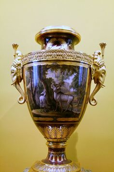Royal Porcelain Factory of Sèvres, Jean-Charles Develly (French, active 1813–1847). Description: 	One of a pair of Clodion vases, given by Louis XVIII of France to Monsieur, his brother, future king Charles X. Hard-paste porcelain and gilt bronze, 1817. Louvre Museum