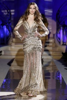 What Would Khaleesi Wear?Zuhair Murad, sparkling with what seem to look like loosed dragon scales, after her dragons grow and shed their own she wears them as armor