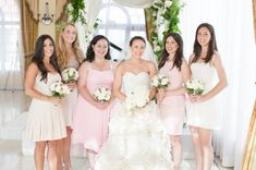 The bridesmaids were dressed in soft shades of pink caring rose nosegays tied with silk cording.