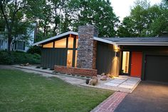 The owners of this midwestern, mid-century modern home wanted a DIY landscape pick-me-up that remained true to the atomic ranch look, all while staying within a budget. The money saved by using a grid of inexpensive precast concrete air conditioner pads swimming in zen-garden-like gravel allowed the budget to include building a low wall to showcase modern house numbers—in Neutraface, of course.