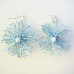 Orecchini bigiotteria fiore azzurro Lavorati a mano by mariceltibijoux.com Light blue earrings Handmade by mariceltibijoux.com