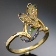 Art Nouveau style is the theme of the dragonfly as well as the use of the enamel. This way of enameling is called plique ajour. 1890-1905 France. Adin Antique Jewellery.