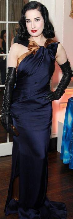 Dita Von Teese: Dress – Carolina Herrera  Gloves – Dita Von Teese Glove Collection  Purse – Tyler Alexandra  Shoes – Christian Louboutin