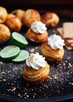 These Key Lime Pie Ebelskivers are fun twist on the classic pie. Filled with lime curd, topped with cream, and sprinkled with graham cracker - Key Lime Yum! Beignets, Aebleskiver Recipe, Poffertjes Recipe, Delicious Desserts, Dessert Recipes, Breakfast Recipes, Sweet Breakfast, Breakfast Dishes, Breakfast Ideas