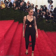 Pin for Later: Who Needs a Met Gala Ticket When You Have Instagram? Cara Delevingne Clad in trousers and faux tattoos, the model brought her signature edginess to the red carpet.