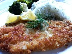 Breaded Petrale Sole.  I used Corn flake breading or panko crust, both with parmesan and lemon juice.  pan fried in cast iron pan.