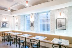 White exposed brick walls surround the new outpost of Russ & Daughters Cafe located in the Jewish Museum on the Upper East Side.