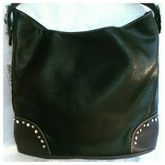 Black Leather Purse Very roomy black leather purse. Detailed side embroidery. Single strap.Top zipper closure. Back zipper pocket. Back cellphone pocket. Embellished with Rhinestones and studs. Montana West Bags Shoulder Bags