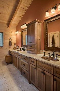 Ample lighting in the bathroom is vital! Drywall spreads light around a room better than wood. This double vanity master bathroom shows the beauty of color in this vaulted ceiling space.
