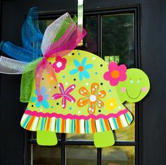 So whimsical and HAPPY!!! Cute turtle is collecting flowers for her bright shell! Great addition to your Spring or Summer decorations. Summer Door hanger has been glittered and comes with a shimmery bow!  Measures 30x20 Bow Height not included but adds several inches.  Message me with any personalization. Its free!  More Spring and Summer Door Hangers: http://www.etsy.com/shop/LooLeighsCharm?section_id=11146548&view_type=gallery  More doorhangers at www.etsy....