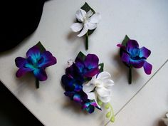 hand dyed blue/purple and white orchid buttonholes and corsage. Love the color.