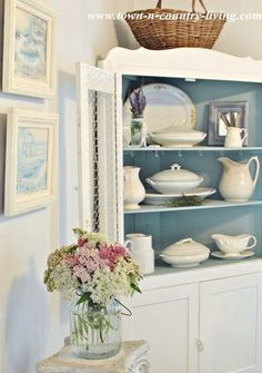 Dining hutch holds white ironstone - painted chicken wire  instead of glass cabinet fronts for a farmhouse look
