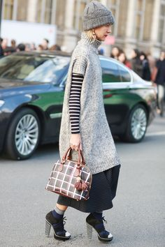 Natalie Joos in gray and stripes. Paris Fashion Week #Streetstyle Fall 2014 #PFW