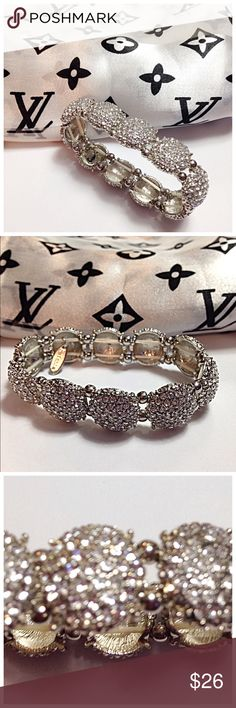 """NWOT, Natasha Couture, Crystal Stretch  Bracelet NWOT, Nordstrom's - Natasha Couture, Clustered Crystal, Silver Stretchy Bracelet. Double durable stretch bands are under each side & fits """"OS"""" wrists.✅measures 7"""" flat (before stretched). Gorgeous individual round shapes are encrusted with shiny crystals & surrounded with double silver bead style balls, set in between each jewel. Hallmarked """"Natasha"""" tag is attached (5th pic). This is BRAND NEW, removed tags after purchased & has never been…"""