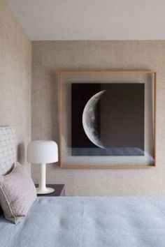 A nice example for float framing. The image is sandwiched between clear glass or acrylic. The wall behind is visible, a simple natural wood frame-elegant.