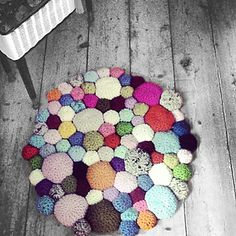 This is crochet - but I love this nubbly Pebbles Rug. It looks like so much fun. I want to do one in varying shades of green so it looks like a patch of mixed moss. #knitindie