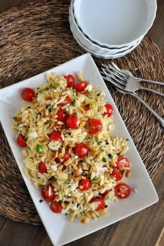 Fast and Fresh Orzo Salad with Tomatoes, Basil and Feta. The flavors are amazing – everything from fresh tomatoes to creamy feta. Fragrant basil to toasted pine nuts.