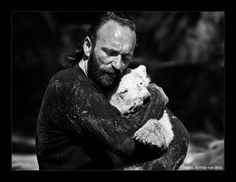 Thomas Dörflein (13 October 1963 – 22 September 2008) was a German zookeeper at the Berlin Zoological Garden for 26 years. After the polar bear cub Knut was abandoned by his mother shortly after his birth in 2006, Dörflein was assigned as the cub's caretaker. As a result of the zoo's controversial decision to raise Knut by hand, and the resultant close relationship between keeper and animal, Dörflein became a reluctant celebrity.    Knut adored him and followed him around like a puppy.