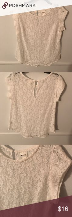 White lace short sleeve blouse Never worn only tried on white lace top with keyhole back closure! Comment with any questions Stylus Tops Blouses