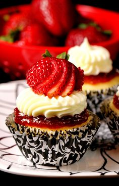 Cheesecake filled Vanilla Cupcake with Strawberry Puree and Whipped Cream Cheese Frosting.