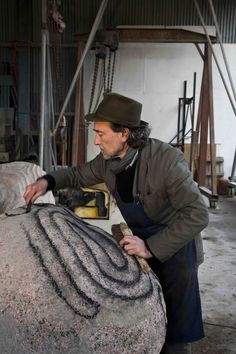 Sculptor Peter Randall Page in his workshop, Devon, England.