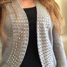 Studded Grey Sweater Host Pick. Edgy grey studded open sweater. size M. 60% cotton, 20% viscose and 20% poly. Comfy and stylish. No stains, holes or signs of wear. No studs missing. Would also fit a small. Beldini Sweaters