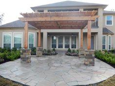 Arizona oak flagstone patio with oklahoma chop rock columns and cedar pergola
