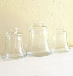 A personal favorite from my Etsy shop https://www.etsy.com/listing/279627818/trio-of-clear-glass-bell-jars-with-lids