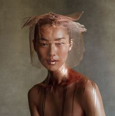 Liu Wen by Patrick Demarchelier for Vogue US, February Editorial beauty photo. Copper netting over hair and face. Metallic bronze paint on body.