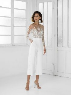 Lace long sleeve cropped straight leg wedding jumpsuit with pockets - - Tailored Braham Rime Arodaky white bridal jumpsuit with flare trousers. Naked skin bodice with delicate embroidered flowers. Jumpsuit Prom Dress, Wedding Jumpsuit, White Jumpsuit, Minimalist Dresses, Dinner Outfits, Bridal Outfits, Outfits For Weddings, Jumpsuits For Weddings, Prom Outfits