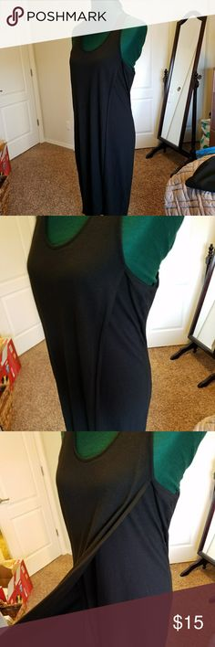 Black Racerback Dress Such a cute casual summer dress! Black t-shirt material. I love the open flap on the front! Hugs your curves without being skintight. No flaws. GAP Dresses