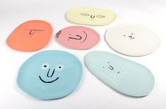 French illustrator Jean Jullien painted happy, sad and unimpressed expressions for his new collection of plates.