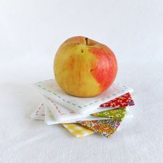 Set of 4 white linen coasters with colorful accent form Join us for Dinner
